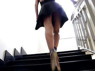 Girl in Little Black Dress. Upstairs Upskirt