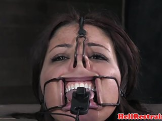 Gagged sub canned while mouth opened