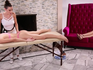 Two sexy masseuses sharing sweet pussy on massage table