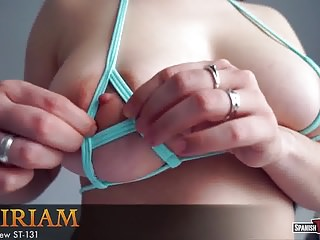 Young girl with huge natural tits in g-string