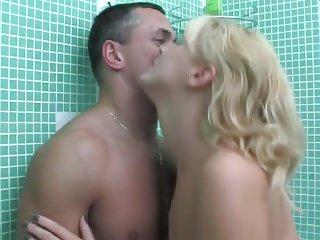 Mature seduces a guy in the bathroom