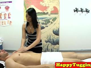 Doggystyled oriental masseuse makes cock cum