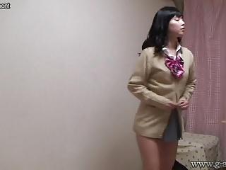 Naked Japanese Schoolgirl wears a Miniskirt School Uniform