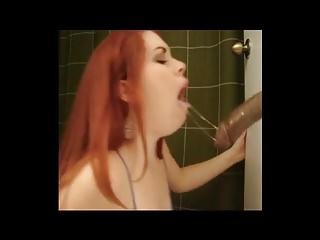 Redhead sloppy dildo suck and deepthroat