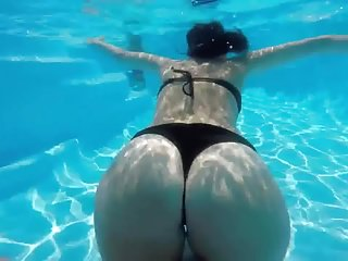Woman receives wedgie underwater